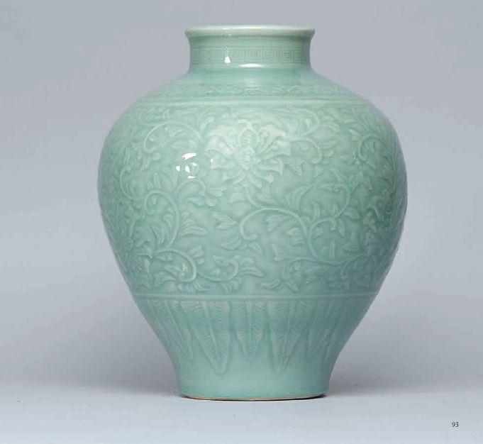 A carved celadon-glazed 'Lotus' jar, Qing dynasty, 18th century