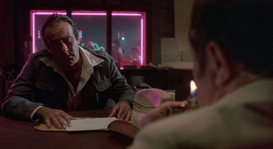 From Coens' BloodSimple.  The style propagates through films as a highlight, a bit of extra-stylishness in films that include regular looking moments.  BloodSimple is about 50/50