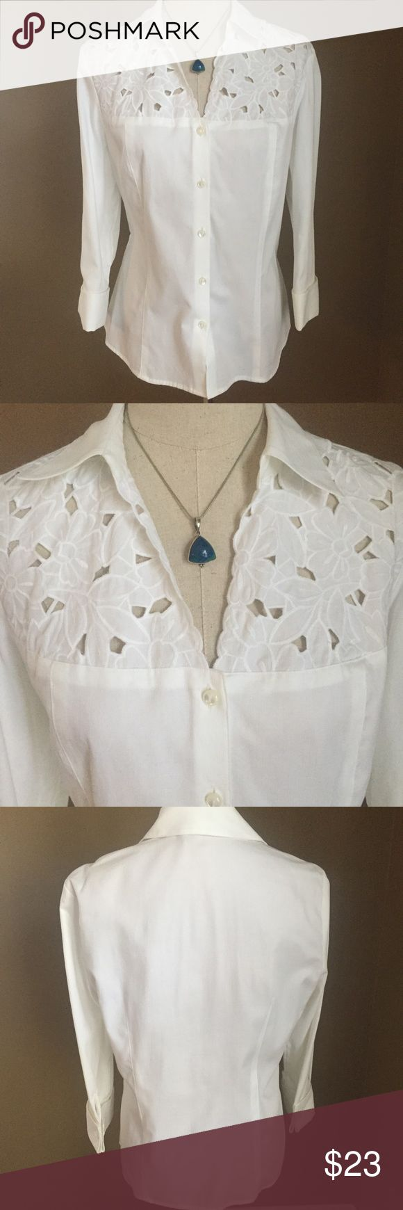 """JONES NEW YORK SIGNATURE White Floral Blouse This blouse is a showstopper! The beautifully detailed and outlined florals are eye catching. There are five pearl buttons to accentuate the front. Sleeves are 3/4"""". There are very clean lines in the front and back which lend itself to a slimming effect. This shirt looks its best when ironed or steamed. 100% cotton/machine wash cold. This blouse has been very well taken care of (only worn once) and is looking for a good home. ❤️ Jones New York…"""