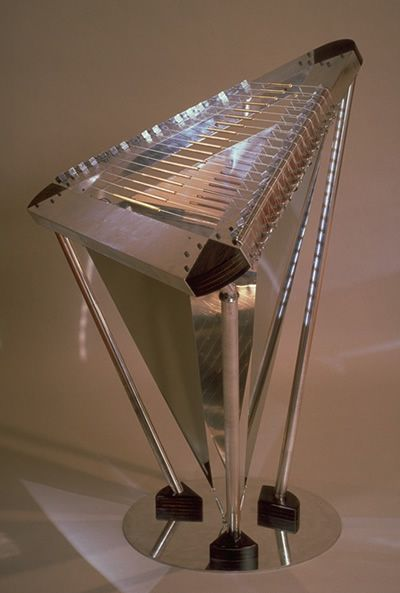 Trylon      The Trylon instrument is built using aluminum, stainless steel, brass, wood, guitar strings, magnetic and piezo pickups.    The Trylon was invented and created by Oliver DiCicco of the group Mobius Operandi