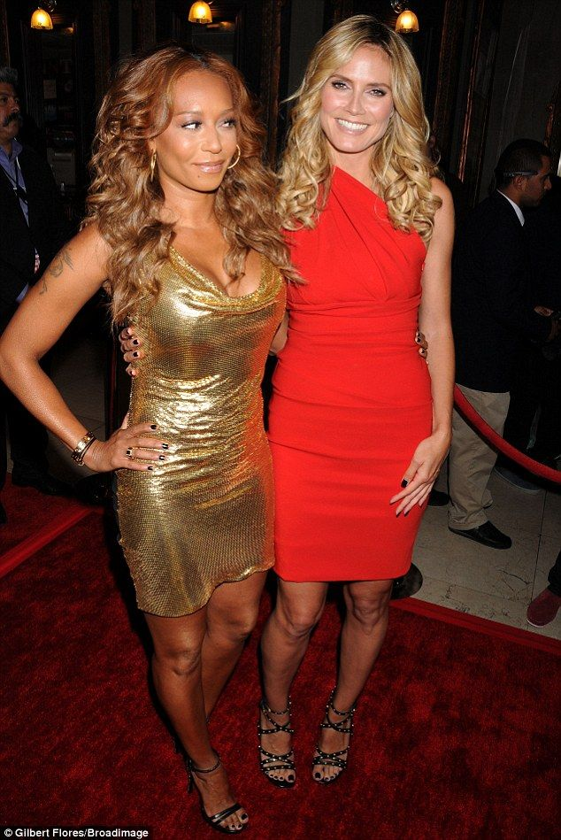 Giving her the eye: Mel B fails to crack a smile as she poses with Heidi Klum at…