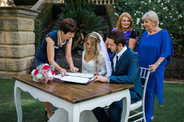 Bride and Groom signing marriage certificate  Timika Prygoda Woodnote Photography