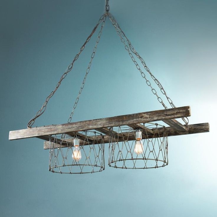 Rustic Ladder Island Chandelier Rustic chain and wire baskets create this farm house inspired island chandelier. The wood ladder has a slight white wash for an old barn wood patina look. The rustic iron chain hangs from each corner of the ladder to a center canopy. The perfect chandelier over a big farm house table or butcher block kitchen island