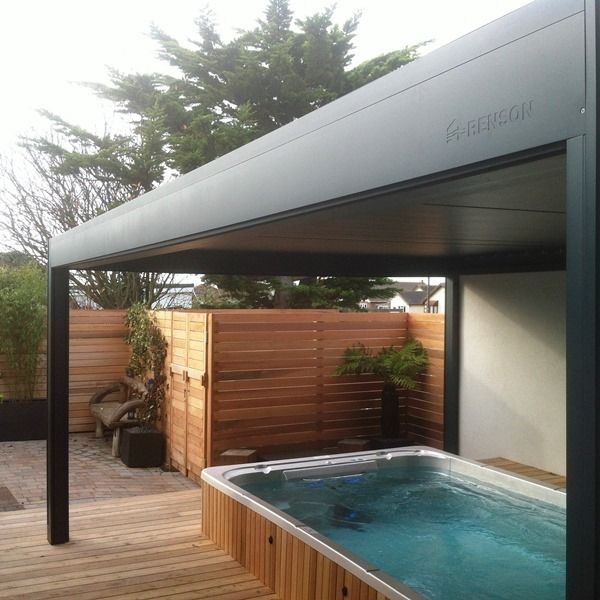 Renson Camargue designed and installed by Garden House Design with Hydropool Swim Spa to give our client the perfect all year round outdoor space. Styled with soft cedar paneling, decking and fences.