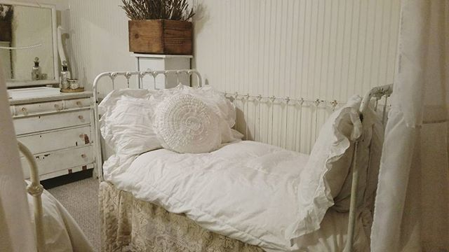 Antique crib turned into a daybed