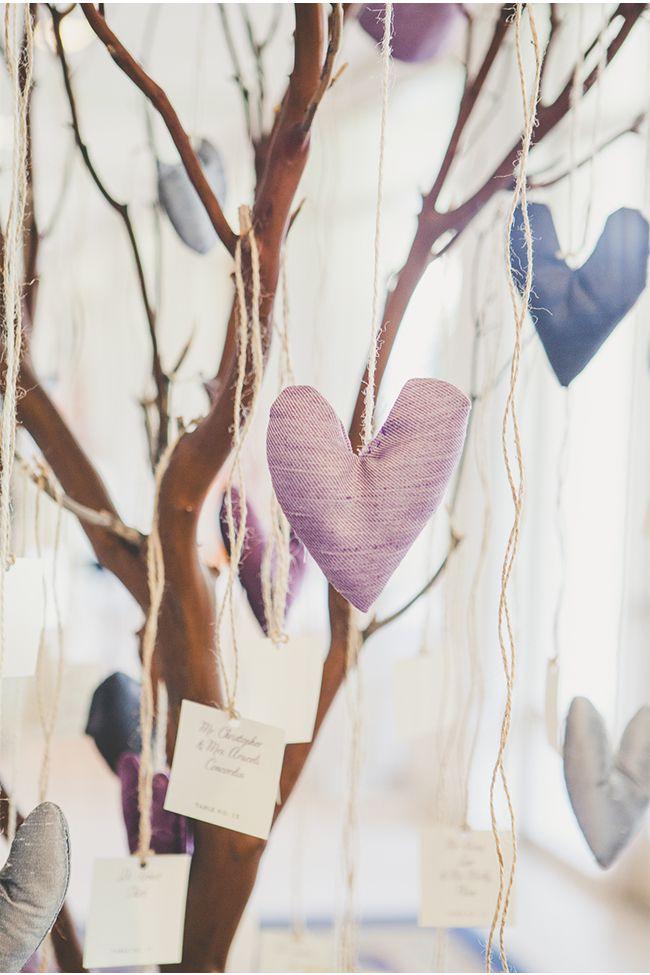 An Escort Card Tree with Hanging Hearts / Christine Farah Photography / via StyleUnveiled.com