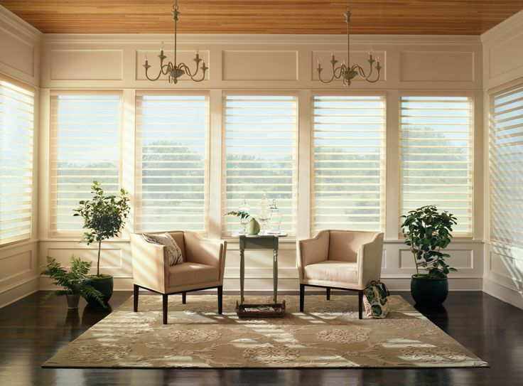 on tone neutral palette adds interest and sophistication to this living room design with silhouette window shadings hunter douglas window treatments - Living Room Window Coverings