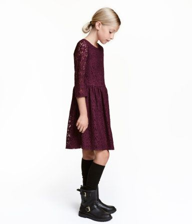 Burgundy. Long-sleeved lace dress with visible back zip, seam at waist, and flared skirt. Lined.