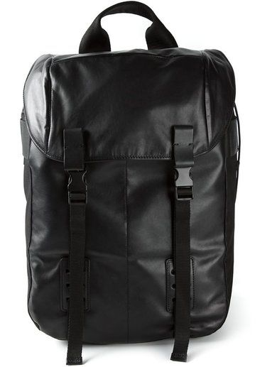 'Black calf leather double buckle backpack from Lanvin featuring a foldover top, a flat top handle, a drawstring fastening and adjustable shoulder straps.'