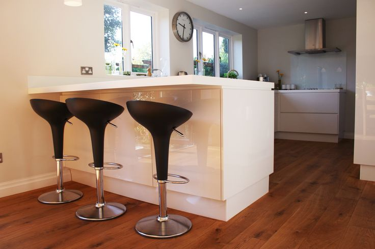 Modern kitchen renovation with a breakfast bar.  For a free consultation call: 0113 262 5954 http://www.redesignexperts.co.uk/