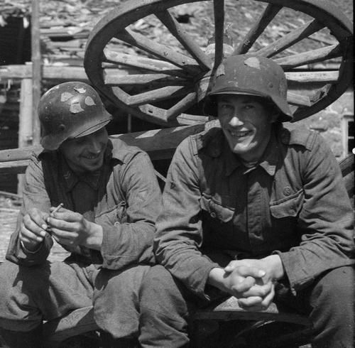 Soldiers of JR 12 resting at farmyard in Ihantala, 11 July 1944, 2 days after the end of Battle of Tali-Ihantala.
