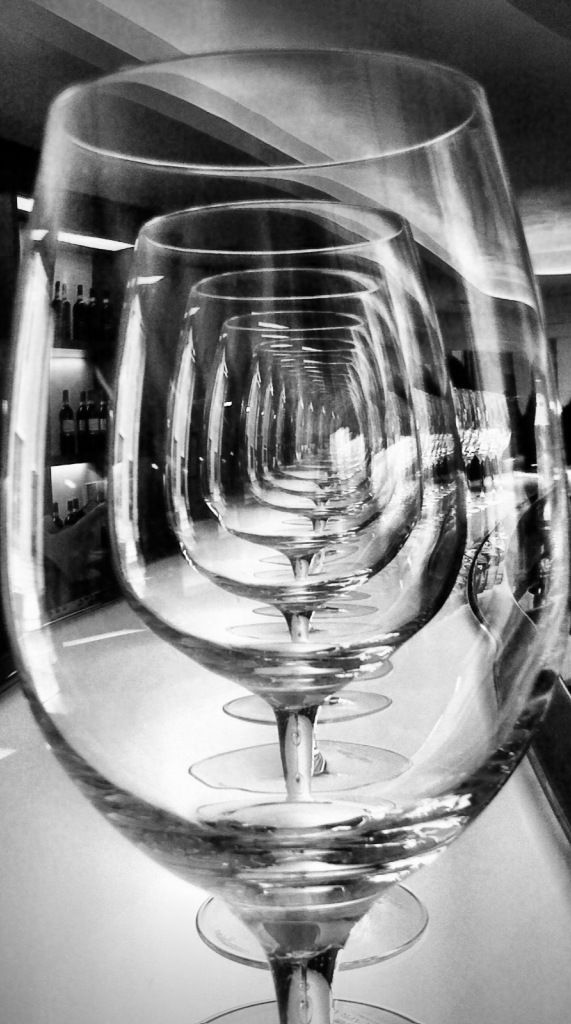 This photo uses an interesting mix of transparency to play with values and contrast. The repetition of the glasses creates depth.