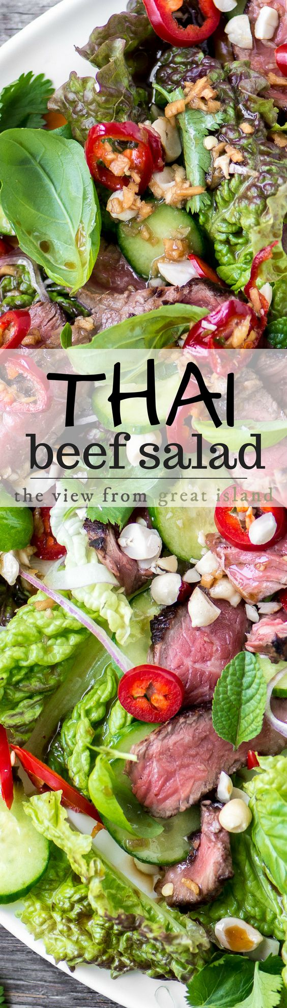 Thai Beef Salad ~ it's in a league all by itself, with ribbons of rare steak, tons of fresh herbs like basil, mint, and cilantro, feathery slices of red onion, crunchy cukes, hot peppers, and a tangy garlic ginger dressing ~ can you resist?