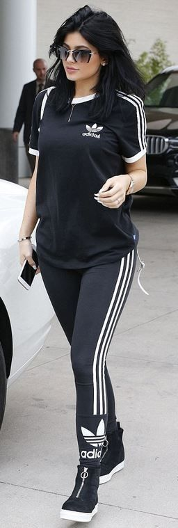 Kylie Jenner: Bracelet – Cartier  Watch – Rolex  Shirt and pants – Adidas Originals  Sunglasses – Miu Miu