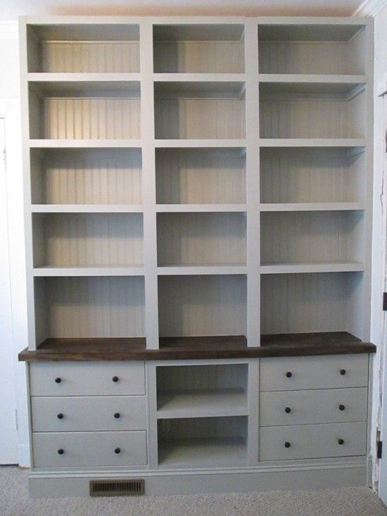 drawers on the bottom, dark shelf at standing height, white shelves the rest of the way up