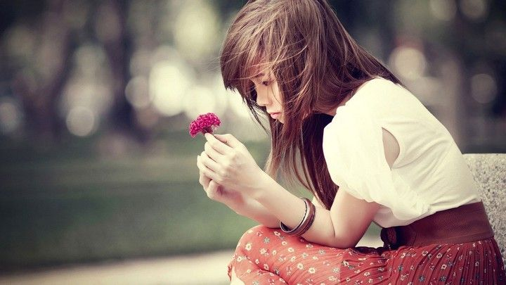 Sad Korean Girl With Red Flowers