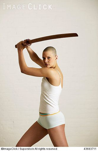 RM 43683711 Young woman posing with a bokken :: ImageClick