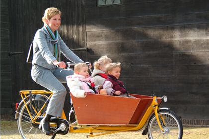 Bakfiets (or cargo bike) is something you'll see often in the Netherlands too.  Usually it's mom or dad taking the children to school or to the shopping centre (winkelcentrum).