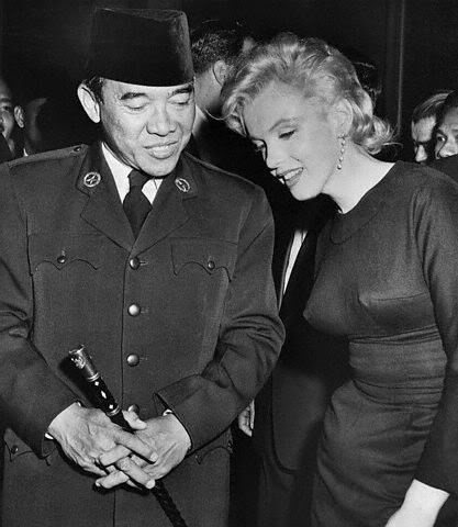 Marilyn Monroe and President Sukarno of Indonesia  -- rumour has it he requested a private audience with her. No idea why?