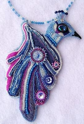"Artbeads reviewer ""mehcrame"" used our Swarovski rivolis in her embroidered peacock focal and the result is fabulous! We love all of the colorful details!"