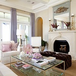living rooms - P Kaufmann Slick pink pillow tan walls wall French doors lilac silk drapes fireplace arched doorways plum velvet tufted cube ottomans glass-top coffee table white slipcover chairs