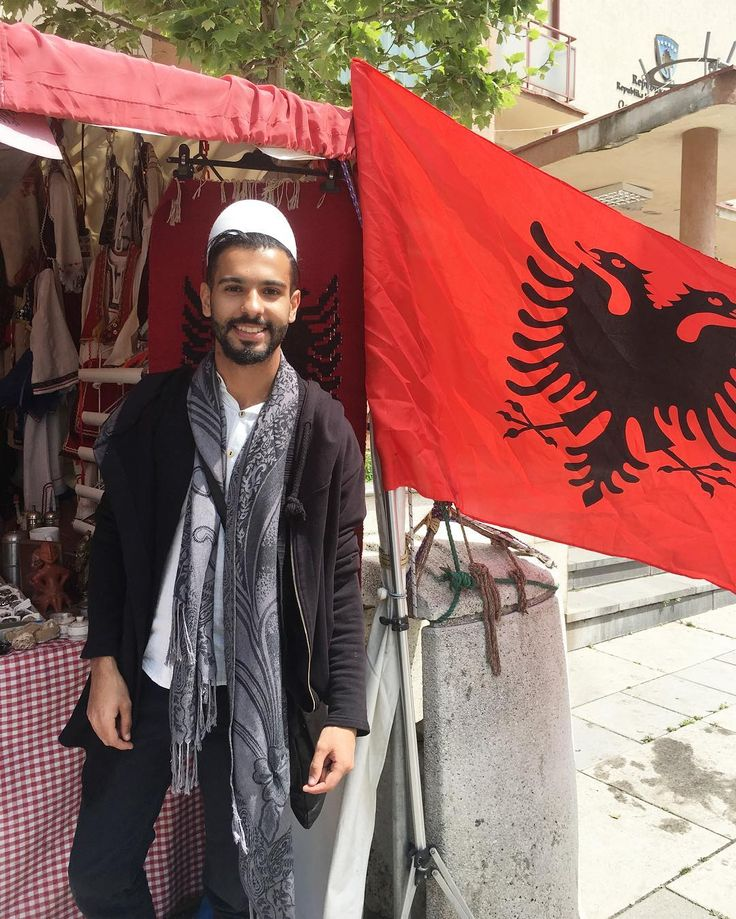 #TB beside Albania flag in #Kosovo   #History: Do you know that  Kosovo is the disputed borderland between #Serbia and Albania. About 90% of its two million inhabitants are Kosovo Albanians (#Kosovars). #AroundTheWorld #2017