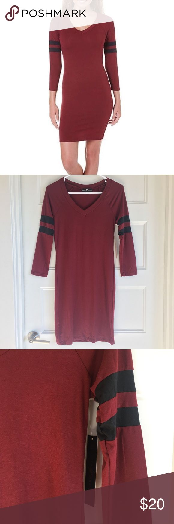 Almost Famous Dress New with tags dress by Almost Famous, size medium (Juniors). Above the knee, long sleeved dress with varsity stripes on the sleeves. Burgundy with black stripes. Super flattering! Almost Famous Dresses