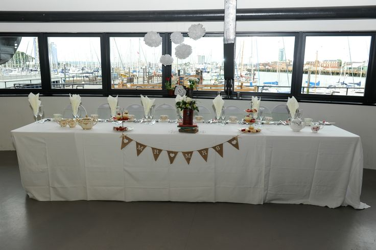 Head table in front of the view across Portsmouth Harbour to the Spinnaker Tower from Alisha's event photography photoshoot