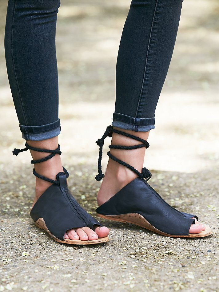 slip on leather sandals with a braided suede wraparound strap