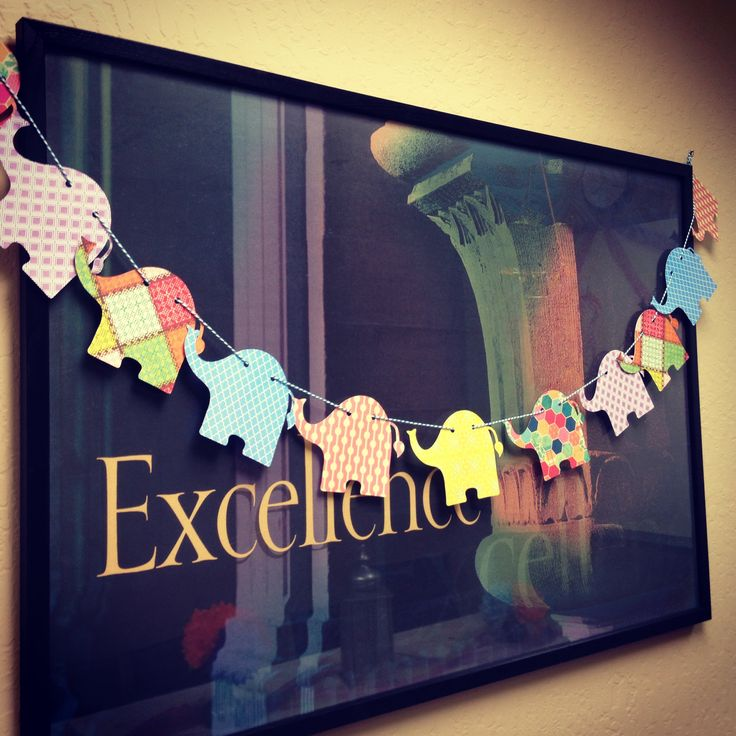 Elephant baby shower - take elephant cookie cutter or similar item and stencil shape onto scrapbook paper to make cute garland!!