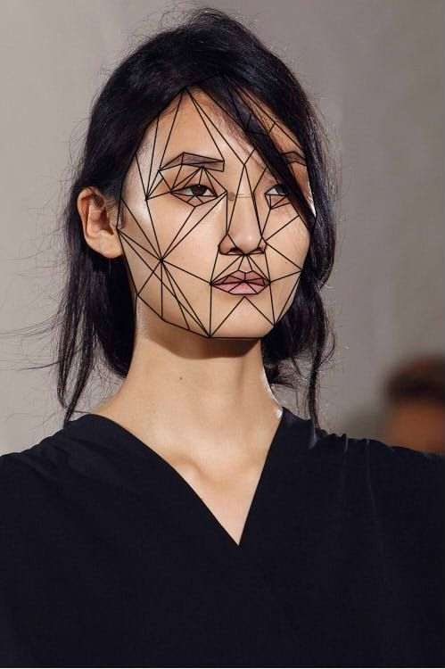 Comic book-inspired lines. Visual contrast in the harsh black lines and organic nature of face.