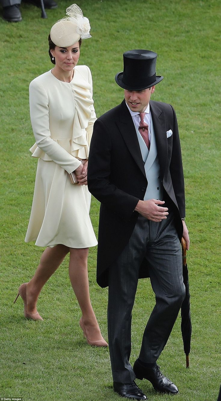 William chose a black suit with a maroon patterned tie and clutched a large umbrella in case of any downpours