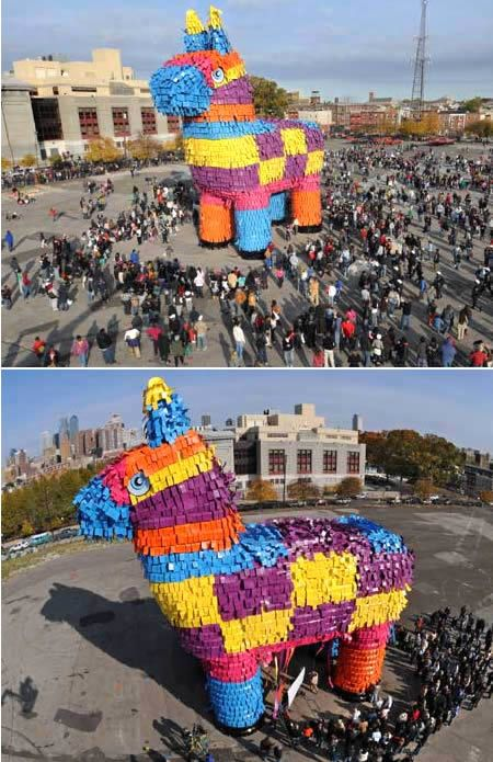 World's Largest Pinata - Breaking the Guinness Record for the world's largest pinata, according to an onsite Guinness adjudicator, this giant mock donkey measured 28.5 meters long; 7.2 meters wide and 18 meters tall and was filled with 8,000 pounds (3,628 kilograms) of candy. A wrecking ball was used to help smash the pinata during a public event, where Carnival Cruise Lines was producing a television commercial.