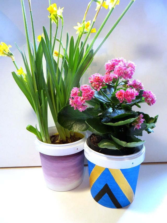 Gradient and Tribal Flower Pots Recycle DIY. Paint old yogurt buckets with acrylic paints to turn them into cute flower pots or pen holders. Decorate with a gradient, stripes, triangles or tribal patterns. Click through for the tutorial, painting tips + video!