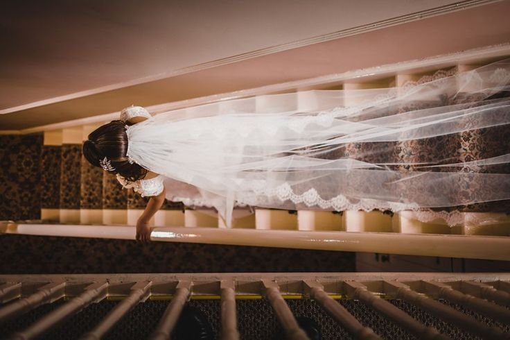 Bride walking down the stairs.  Corin Bishop Photography