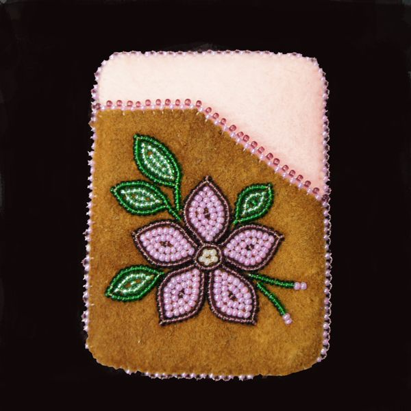 Hand beaded pink card holder made by a Dene artist in Fort Liard Northwest Territories. Carry your debit, credit and I.D cards around in style with this unique card holder, made of moose hide with a pink stroud interior and a beaded flower design.Hand crafted with care in Fort Liard, Northwest Territories in Canadas far North. Support local NWT artists and buy online now.