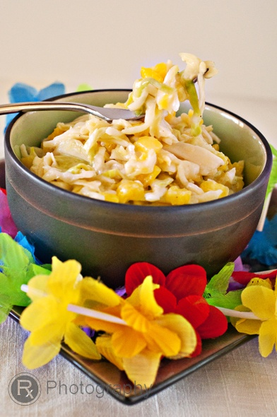 6 cups of shredded green cabbage or 1 head of cabbage, shredded 1 1/4 cup of fresh pineapple, chopped into small dice 1/3 cup plain, non-fat Greek yogurt 2/3 cup of reduced-fat mayonnaise 1 1/2 tablespoons agave syrup 3 tablespoons apple cider vinegar Salt and pepper, to taste