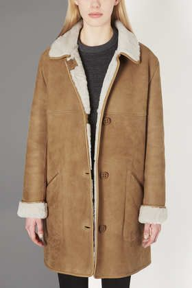 Ultimate Sheepskin Coat by Boutique. When I lived in NYC I always wanted one of these REAL sheep skin coats -- so warm and soft