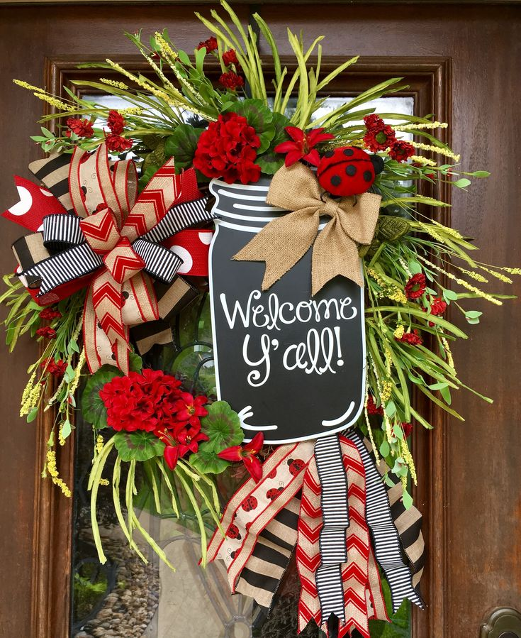Large mason jar and ladybug wreath.  Stunning!  www.facebook.com/southernsass