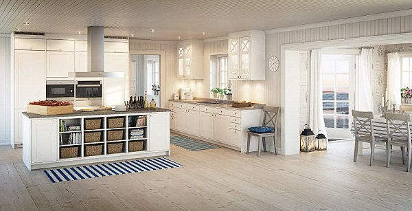 calm Scandinavian Kitchen with fun textile rugs, recessed dining area and organized island