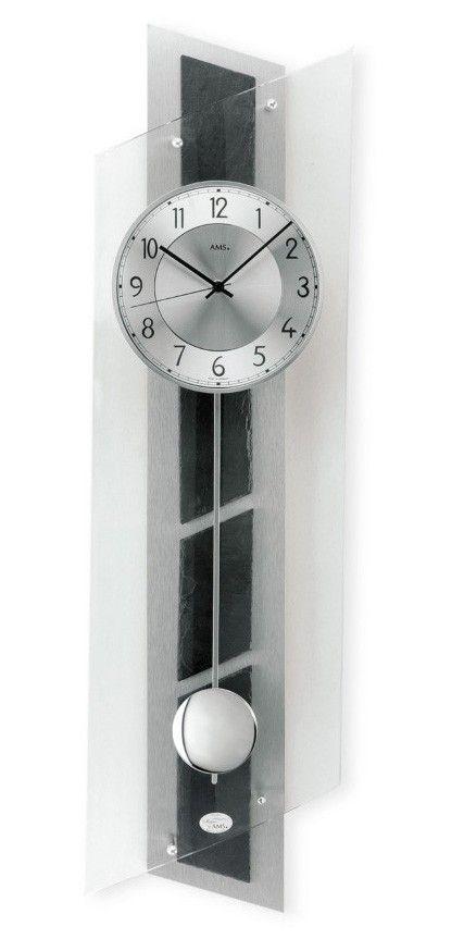 AMS Wandklok 7217. Zeer mooi uitgevoerde designklok van AMS. Voorzien van een hoge kwaliteit Duits quartz uurwerk. De achterwant is van aluminium belegd met lei-steen en deze klok is voorzien van gebogen glas. De slinger is verchroomd en de benodigde energie wordt geleverd door een batterij. De klok wordt geleverd met 2 jaar garantie op het uurwerk. https://www.timefortrends.nl/wekkers-klokken/ams-klokken.html