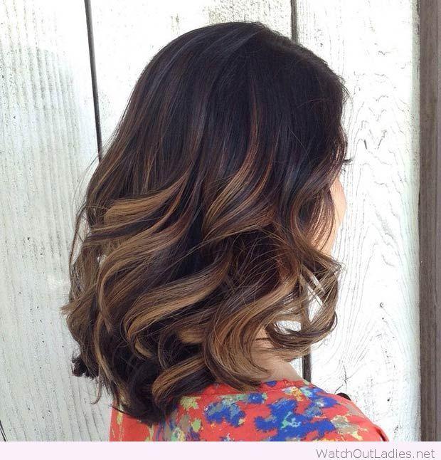 Big bouncy curls lob with caramel highlights