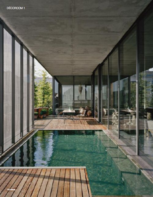 Wood decking is a great alternative to tile and less slippery when wet.