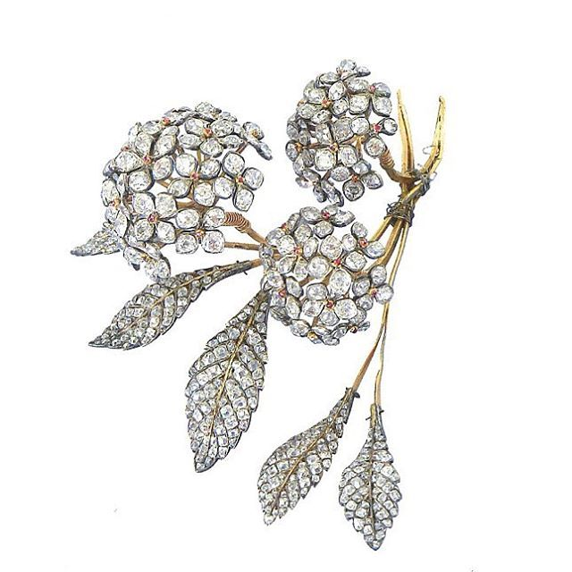 A story of Hortensias... It all begins with the considerable orders of the empresses Joséphine and Marie-Louise and after them the queen Hortense, who wore hortensias bouquets as corsage brooches or garlands. Hortensias bouquet brooch of the queen Hortense in gold, diamonds and rubies.