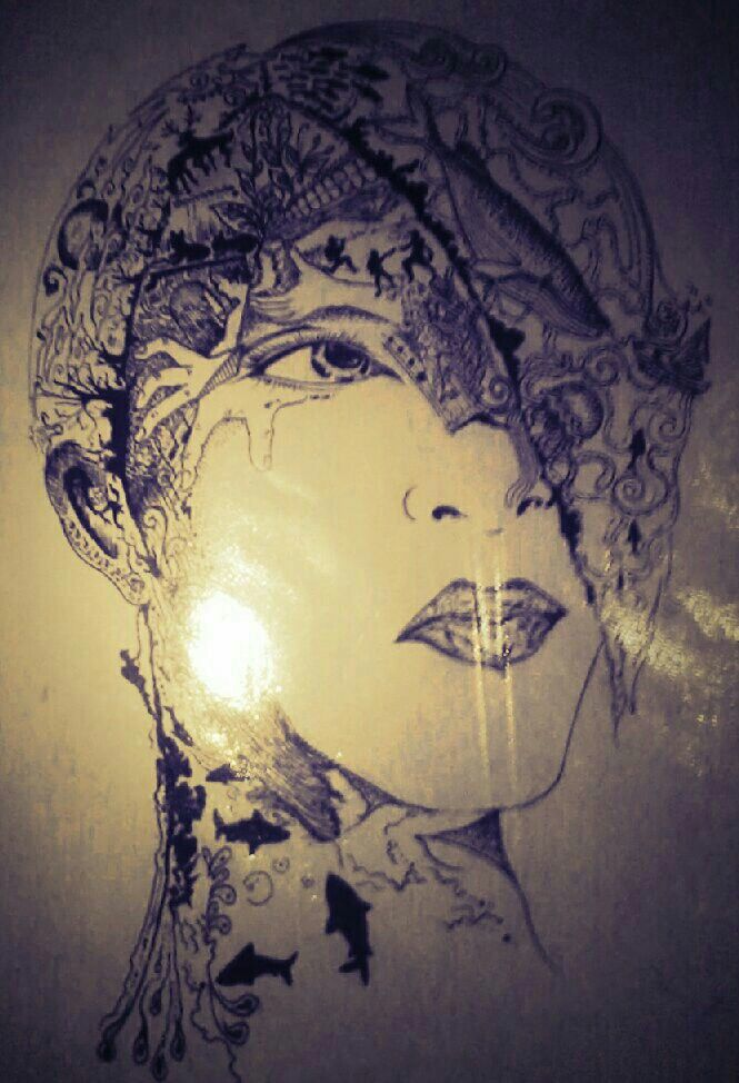 Drawing kolase. Face girl. Ink monochrome.