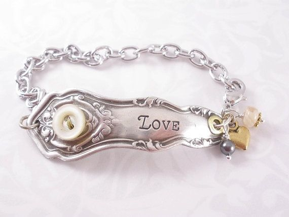 """I adore this cute little bracelet.  It has, """"John 4:19"""" hand stamped on the back of it, too.  Totally my style."""