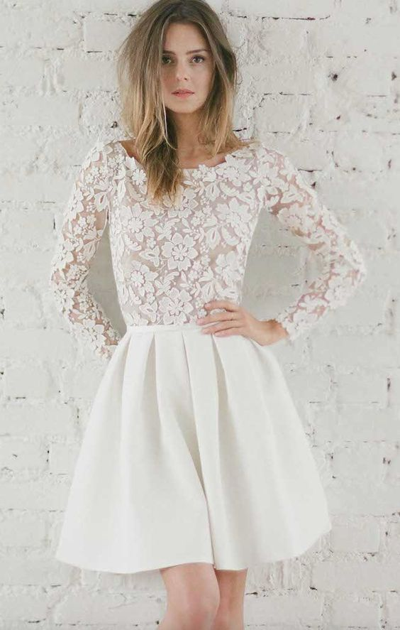 Adorable lace long-sleeve short skater wedding dress; Featured Dress: Rime Arodaky