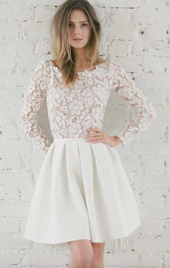 Adorable lace long-sleeve short skater wedding dress; Featured Dress: Rime Arodaky