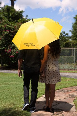 "- Replica of the yellow umbrella seen on How I Met Your Mother - ""Right Place, Right Time"" printed in black across one panel, reminds us to believe in fate - Auto open umbrella, Black curved handle, b"