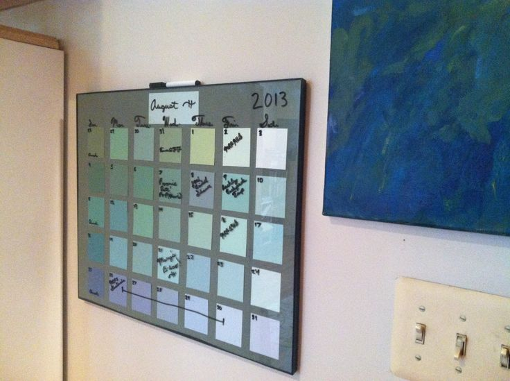 Calender made from paint color samples at Ace Hardware - put behind a cheap glass frame.  Easy to write on and erase.  Plus, you don't have to throw it out at the end of the year!